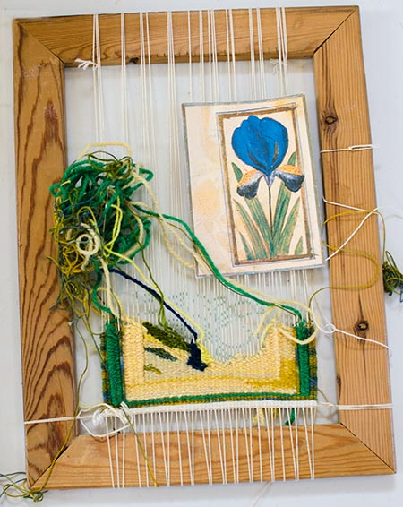 Woven tapestry being made on a frame