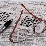 Crossword, pen, and glasses