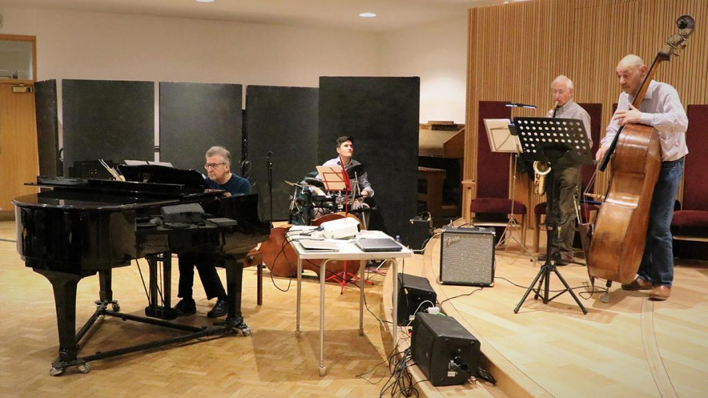 Pianist, drummer, saxophonist, and double bass player